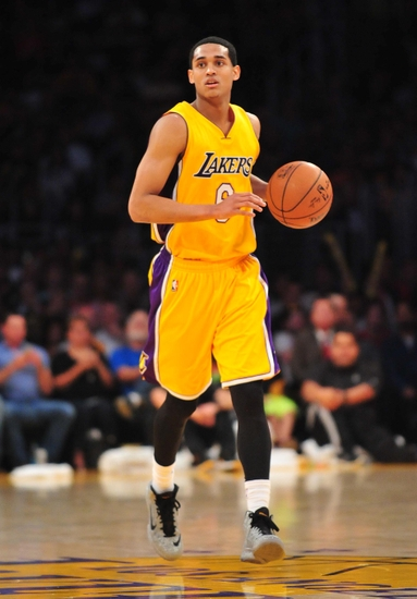 April 3, 2015; Los Angeles, CA, USA; Los Angeles Lakers guard Jordan Clarkson (6) moves the ball up court against the Portland Trail Blazers during the second half at Staples Center. Mandatory Credit: Gary A. Vasquez-USA TODAY Sports